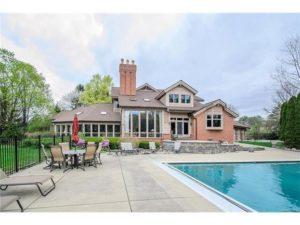 spacious backyard patio with pool