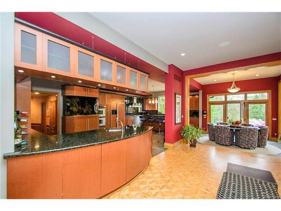 stunning modern kitchen with black granite counters