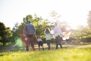 family walking at a plymouth mi park