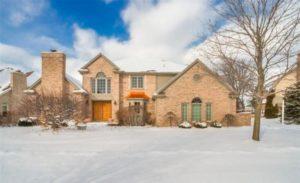 Spacious home with brick exterior.