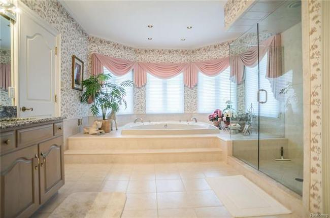 master bathroom and soaking tub in plymouth mi luxury home