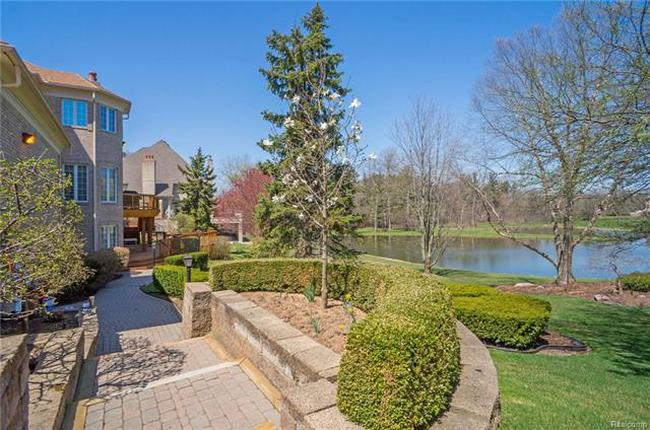 stunning backyard pond in plymouth mi luxury home