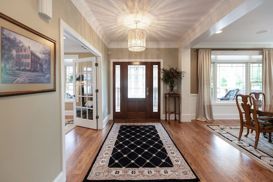 The home's foyer, with access to both the formal dining room and office with bathroom.