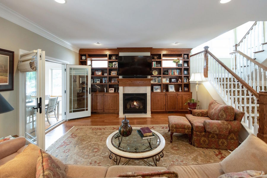 A beautiful living room with a fireplace and built-ins.