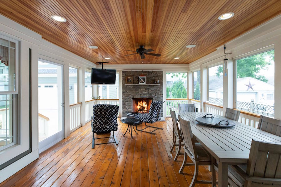 An expansive back porch with fireplace.