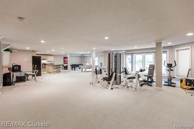 The expansive flex space in this luxurious home, filled with exercise equipment, games, and instruments.